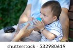 child quenches thirst with... | Shutterstock . vector #532980619
