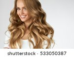beautiful curly hair. smiling... | Shutterstock . vector #533050387