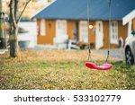 Children's Swing In The Backyard