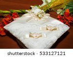wedding gold ring on a cushion... | Shutterstock . vector #533127121
