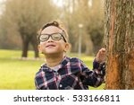 Little Boy With Glasses...