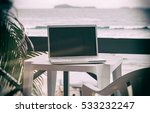 computer on table outside on... | Shutterstock . vector #533232247