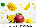 mango with flying slices on a... | Shutterstock . vector #533307484