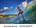 surfer girl riding in the wave. | Shutterstock . vector #533345875