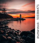 Small photo of Fort Pickering (Winter Island) Lighthouse at sunrise Located in Salem, Massachusetts