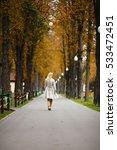 beautiful blonde in a raincoat... | Shutterstock . vector #533472451