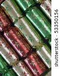 an arrangement of colourful metallic christmas crackers - stock photo