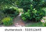 A Brick Garden Path Bordered B...