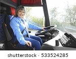 female driver sitting in bus | Shutterstock . vector #533524285