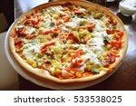 whole italian pizza on wood... | Shutterstock . vector #533538025