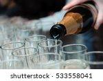 glasses of popping champagne | Shutterstock . vector #533558041