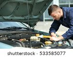 mechanic with scan tool... | Shutterstock . vector #533585077