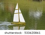 remote sailboat gliding through ... | Shutterstock . vector #533620861