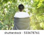 Woman Using A Wheelchair In A...