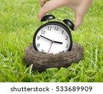 Woman Hand Holding Alarm Clock...