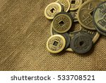 Old Chinese Coin On Sackcloth