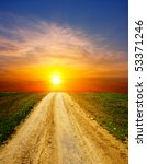 sunset over rural road - stock photo