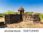 Small photo of Corjuem Fort is a fortress situated 4 kilometres (2.5 mi) from the village of Aldona on the river island of Corjuem, Goa. It was a military fortress for the defense of Portuguese India.