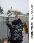 Small photo of DUNGAVEL DETENTION CENTRE, STRATHAVEN, SCOTLAND, 7TH MAY 2016 - Protester wearing jacket with several antifascist and anarchist signs on