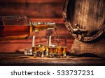 pouring whiskey from bottle to... | Shutterstock . vector #533737231