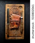 grilled beef on a board  a... | Shutterstock . vector #533802061