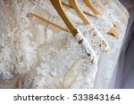 Wedding dresses hanging on a...