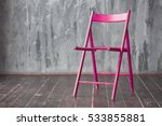 Pink Wooden Chair Standing In...