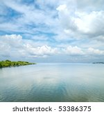 river under low clouds - stock photo