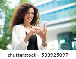 Smiling Businesswoman Using Her ...
