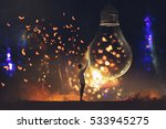 man and big bulb with glowing... | Shutterstock . vector #533945275