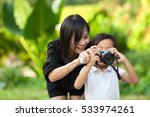 beautiful child taking pictures ... | Shutterstock . vector #533974261