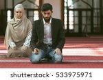 muslim man and woman praying in ... | Shutterstock . vector #533975971