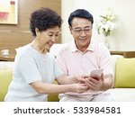 senior asian couple sitting on...   Shutterstock . vector #533984581