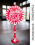 Small photo of Christmas Decoration with Santa Stop Here Sign