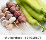 shallots and garlic with green... | Shutterstock . vector #534015679