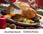carving roasted herb rubbed... | Shutterstock . vector #534019261