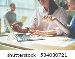 business team working on a... | Shutterstock . vector #534030721