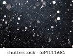 falling snow on black background | Shutterstock . vector #534111685