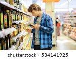 man shopping in supermarket... | Shutterstock . vector #534141925