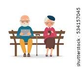 elderly couple sitting on a... | Shutterstock .eps vector #534157045