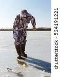 woman on winter fishing. | Shutterstock . vector #534191221