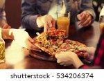 friends taking slices of tasty...   Shutterstock . vector #534206374