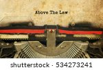 Small photo of Above The Law typed words on a vintage typewriter with vintage background