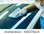 a man blur cleaning car with... | Shutterstock . vector #534274615
