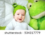 Little Boy In Knitted Animal...