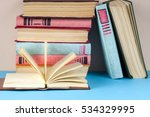 Open Book  Stack Of Colorful...