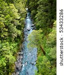 Top view at a  stream in rain forest at New Zealand - stock photo