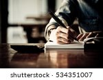 close up women hand on writng... | Shutterstock . vector #534351007