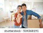 happy couple showing keys of... | Shutterstock . vector #534368191