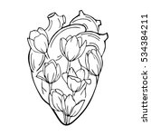 the human heart with tulips... | Shutterstock .eps vector #534384211